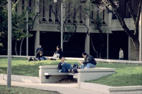 Students enjoy a break from classes outside on the campus quad in front of Burnham Hall